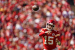 Kansas City Chiefs quarterback Patrick Mahomes (15) throws during the second half of an NFL football game against the Los Angeles Chargers, Sunday, Sept. 26, 2021, in Kansas City, Mo. (AP Photo/Charlie Riedel)