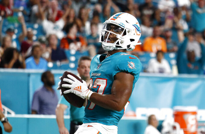 Miami Dolphins running back Myles Gaskin scores a touchdown during the second half of the team's preseason NFL football game against the Atlanta Falcons, Thursday, Aug. 8, 2019, in Miami Gardens, Fla. (AP Photo/Brynn Anderson)