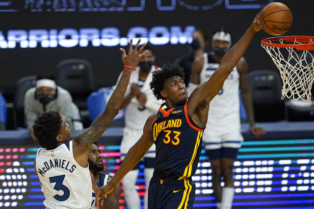 Golden State Warriors center James Wiseman (33) dunks against Minnesota Timberwolves forward Jaden McDaniels (3) during the second half of an NBA basketball game in San Francisco, Wednesday, Jan. 27, 2021. (AP Photo/Jeff Chiu)