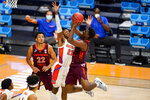Virginia Tech guard Nahiem Alleyne (4) shoots over Florida guard Scottie Lewis (23) in the first half of a first round game in the NCAA men's college basketball tournament at Hinkle Fieldhouse in Indianapolis, Friday, March 19, 2021. (AP Photo/Michael Conroy)
