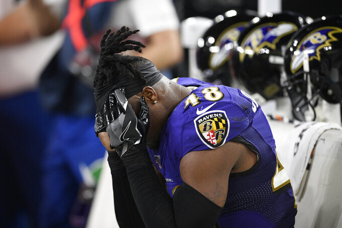 Baltimore Ravens inside linebacker Patrick Onwuasor (48) sits on the bench after an NFL divisional playoff football game against the Tennessee Titans, Saturday, Jan. 11, 2020, in Baltimore. The Titans won 28-12. (AP Photo/Nick Wass)