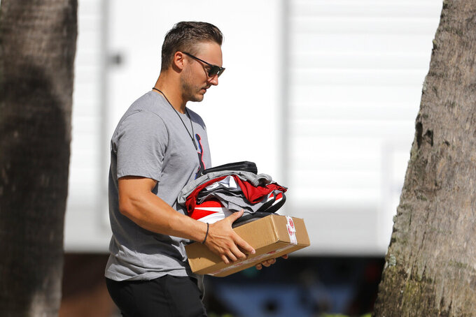 St. Louis Cardinals catcher Andrew Knizner leaves the team's spring training baseball clubhouse, Friday, March 13, 2020, in Jupiter, Fla. Major League Baseball has delayed the start of its season by at least two weeks because of the coronavirus outbreak as well as suspended the rest of its spring training game schedule. (AP Photo/Julio Cortez)