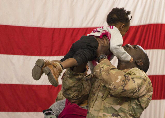 A soldier reunites with his daughter at Fort Bragg, N.C.  after returning from the Middle East. The 82nd Airborne Division's Immediate Response Force had been deployed since New Years Eve. Thursday, Feb. 20, 2020. Nearly two months after a U.S. Army rapid-response force was activated amid tensions with Iran, deploying 3,000 soldiers to the Middle East, some are returning home. By the end of the weekend, nearly 800 paratroopers from the 82nd Airborne Division's Immediate Response Force are slated to have returned to Fort Bragg, North Carolina. On Thursday morning, eager family members waited in the base's iconic Green Ramp to greet their loved ones. (U.S. Army via AP)