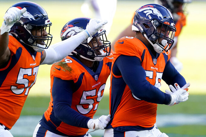 Denver Broncos outside linebacker Bradley Chubb (55) celebrates his sack against the New Orleans Saints with defensive end DeMarcus Walker (57) and outside linebacker Malik Reed (59) during the first half of an NFL football game, Sunday, Nov. 29, 2020, in Denver. (AP Photo/Jack Dempsey)
