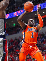Auburn guard Jared Harper (1) shoots during the second half of the team's NCAA college basketball game against Mississippi, Wednesday, Jan. 9, 2019 in Oxford, Miss. Mississippi won 82-67. (AP Photo/Rogelio V. Solis)
