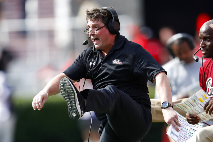 South Carolina head coach Will Muschamp reacts as Georgia misses a field goal in the second half of an NCAA college football game Saturday, Oct. 12, 2019, in Athens, Ga. South Carolina won 20-17 in double overtime. (AP Photo/John Bazemore)