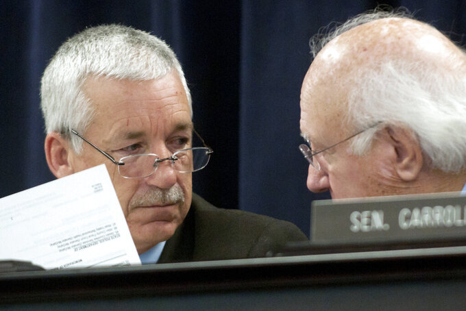 FILE - In this Jan. 10, 2012, file photo, state Sens. Paul Hornback, R-Shelbyville, left, and Julian Carroll, D-Frankfort, speak during a Government Contract Review Committee meeting in Frankfort, Ky. Hornback, a prominent voice on farming as a committee chairman, said Wednesday, June 16, 2021, that he won't seek another term in 2022 but downplayed blistering criticism he received from a fellow Republican, U.S. Rep. Thomas Massie. (AP Photo/John Flavell, File)