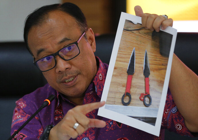 Indonesian National Police spokesperson Brig. Gen. Dedi Prasetyo shows a picture of the knives used in the attack against Indonesian Coordinating Minister for Politics, Law and Security Wiranto, during a press conference in Jakarta, Indonesia, Friday, Oct. 11, 2019. A knife-wielding man suspected of belonging to a radical Islamic group wounded the top security minister, a local police chief and another person in an attack in western Indonesia on Thursday. (AP Photo/Tatan Syuflana)