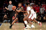 Xavier's Paul Scruggs, left, is defended against by St. John's Nick Rutherford, center, and Greg Williams Jr. during an NCAA college basketball game in New York on Monday, Feb 17, 2020. (Steven Ryan/Newsday via AP)