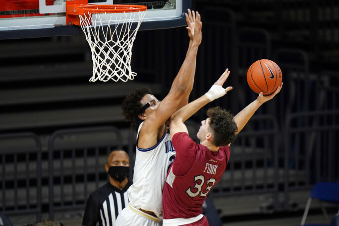 Saint Joseph's Taylor Funk, right, tries to get a shot past Villanova's Jeremiah Robinson-Earl during the second half of an NCAA college basketball game, Saturday, Dec. 19, 2020, in Villanova, Pa. (AP Photo/Matt Slocum)