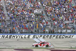 Kyle Larson (5) crosses the finish line to win a NASCAR Cup Series auto race at Nashville Superspeedway Sunday, June 20, 2021, in Lebanon, Tenn. (AP Photo/Mark Humphrey)