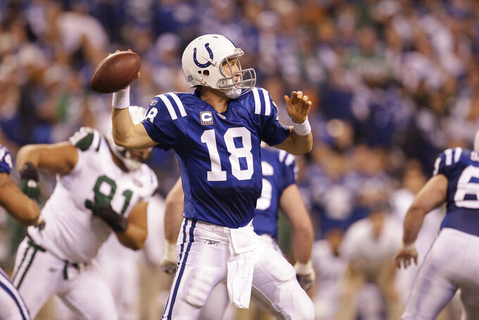 File-This Jan. 8, 2011, file photo shows Indianapolis Colts quarterback Peyton Manning (18) in action during the second quarter of an NFL AFC wild card football playoff game in Indianapolis. Members of a special panel of 26 selected all of them for the position as part of the NFL's celebration of its 100th season. All won league titles except Marino. All are in the Hall of Fame except Brady and Manning, who are not yet eligible.  On Friday, Dec. 27, 2019, quarterback was the final position revealed for the All-Time Team.  (AP Photo/Nam Y. Huh,File)