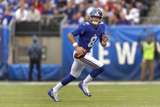 New York Giants quarterback Daniel Jones (8) rolls out of the pocket against the Minnesota Vikings during the first quarter of an NFL football game, Sunday, Oct. 6, 2019, in East Rutherford, N.J. (AP Photo/Adam Hunger)