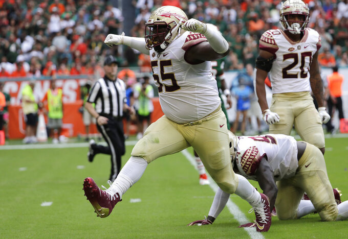Florida State defensive tackle Fredrick Jones (55) celebrates after tackling Miami running back DeeJay Dallas during the first half of an NCAA college football game, Saturday, Oct. 6, 2018, in Miami Gardens, Fla. (AP Photo/Lynne Sladky)