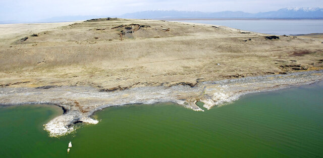 This photo shows Fremont Island in 2012. The Great Salt Lake's third-largest island, Fremont Island, was once the possible destination for thousands of new homes but will now be preserved in its natural state after being sold to an undisclosed nonprofit group. Land Advisors Organization's Salt Lake City office announced the sale of the privately owned, 4,133-acre island on Thursday, Nov. 12, 2020, a transaction that had been in the works for about a year, the Deseret News reported. (Scott G Winterton/The Deseret News via AP)