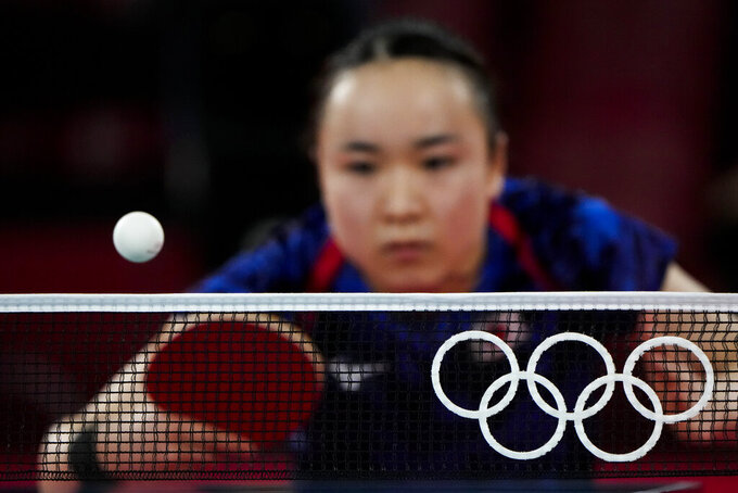 Japan's Mima Ito competes against Singapore's Yu Mengyu during the bronze medal match of the table tennis women's singles at the 2020 Summer Olympics, Thursday, July 29, 2021, in Tokyo. (AP Photo/David Goldman)