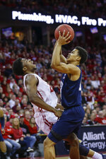 Penn State's Rasir Bolton, right, fouls Wisconsin's Khalil Iverson during the first half of an NCAA college basketball game Saturday, March 2, 2019, in Madison, Wis. (AP Photo/Andy Manis)