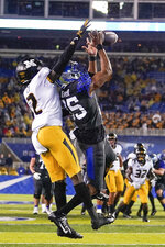 Missouri defensive back DeMarkus Acy (2) breaks up a pass to Kentucky wide receiver Bryce Oliver (85) during the first half of NCAA college football game, Saturday, Oct. 26, 2019, in Lexington, Ky. (AP Photo/Bryan Woolston)