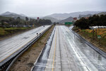 Northbound Interstate 5 in Castaic, Calif., is free of traffic after California's main north-south artery was closed by snow in the Tejon Pass some 30 miles to the north Monday, Jan. 14, 2019. The first in a series of Pacific storms brought heavy rain to Southern California and snow in the mountains Monday, closing some highways and snarling traffic. Weather forecasters have predicted a series of storms, one after the other, could continue to bring rain and snow into the middle of the week. (Hans Gutknecht/Orange County Register via AP)
