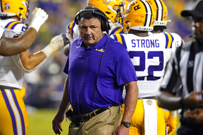LSU head coach Ed Orgeron walks on the sideline during a timeout in the second half of an NCAA college football game against Auburn in Baton Rouge, La., Saturday, Oct. 2, 2021. Auburn won 24-19. (AP Photo/Gerald Herbert)