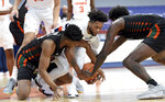 Miami guard Earl Timberlake, left, Syracuse forward Alan Griffin (0) and Miami center Nysier Brooks (3) scramble for a loose ball during an NCAA college basketball game Tuesday, Jan. 19, 2021 in Syracuse, N.Y. (Dennis Nett/The Post-Standard via AP)