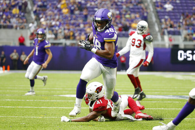 Minnesota Vikings fullback Khari Blasingame  (48) runs from Arizona Cardinals cornerback Nate Brooks (41) during a 15-yard touchdown reception in the second half of an NFL preseason football game, Saturday, Aug. 24, 2019, in Minneapolis. (AP Photo/Bruce Kluckhohn)