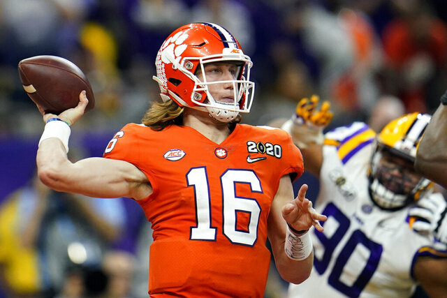 FILE - In this Jan. 13, 2020, file photo, Clemson quarterback Trevor Lawrence throws a pass against LSU during the first half of a NCAA College Football Playoff national championship game in New Orleans. The college quarterbacks class is shaping up nicely, just in time to perhaps rescue some NFL teams from themselves. (AP Photo/David J. Phillip, File)