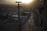 Afghans walk in an alleyway as the sun sets in Kabul, Afghanistan, Thursday, Sept. 16, 2021. (AP Photo/Felipe Dana)
