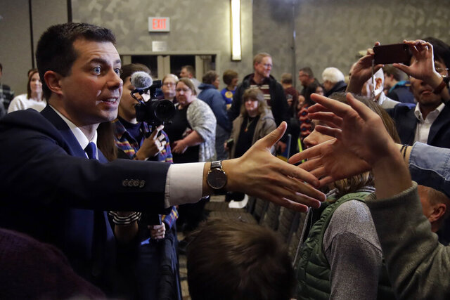 Democratic presidential candidate former South Bend, Ind., Mayor Pete Buttigieg shakes hands with supporters during a campaign event Thursday, Jan. 30, 2020, in Ankeny, Iowa. (AP Photo/Marcio Jose Sanchez)
