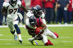 Houston Texans wide receiver Keke Coutee (16) fumble as he is hit by Denver Broncos linebacker A.J. Johnson (45) during the first half of an NFL football game Sunday, Dec. 8, 2019, in Houston. Denver scored on the play. (AP Photo/David J. Phillip)
