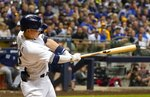 Milwaukee Brewers' Keston Hiura hits a single during the seventh inning of a baseball game against the San Diego Padres Tuesday, Sept. 17, 2019, in Milwaukee. (AP Photo/Morry Gash)