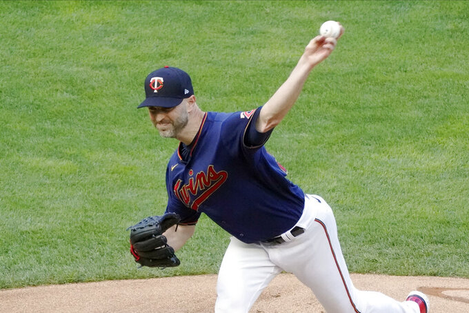 Minnesota Twins pitcher J.A. Happ throws to a Detroit Tigers batter during the first inning of a baseball game Thursday, July 8, 2021, in Minneapolis. (AP Photo/Jim Mone)