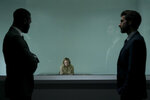 This image released by Universal Pictures shows Aldis Hodge, from left, Elisabeth Moss and Sam Smith in a scene from