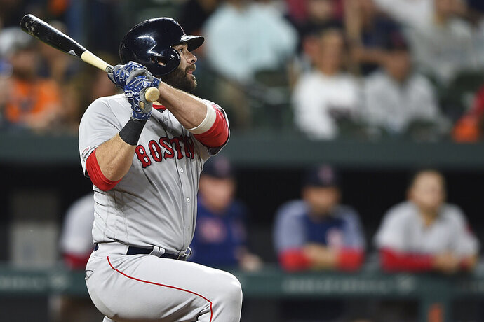 Boston Red Sox's Mitch Moreland watches his three-run home run against the Baltimore Orioles during the fifth inning of a baseball game Tuesday, May 7, 2019, in Baltimore. (AP Photo/Gail Burton)
