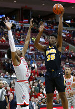 Iowa forward Tyler Cook, right, goes up for a shot against Ohio State forward Andre Wesson during the first half of an NCAA college basketball game in Columbus, Ohio, Tuesday, Feb. 26, 2019. (AP Photo/Paul Vernon)