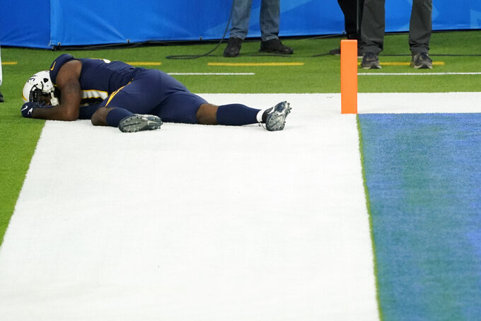 Los Angeles Chargers wide receiver Mike Williams lies on the field after an injury during the second half of an NFL football game against the Las Vegas Raiders, Sunday, Nov. 8, 2020, in Inglewood, Calif. (AP Photo/Ashley Landis)