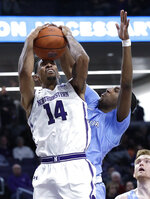 Northwestern guard Ryan Taylor, left, shoots against Columbia guard/forward Rodney Hunter during the second half of an NCAA college basketball game Sunday, Dec. 30, 2018, in Evanston, Ill. (AP Photo/Nam Y. Huh)
