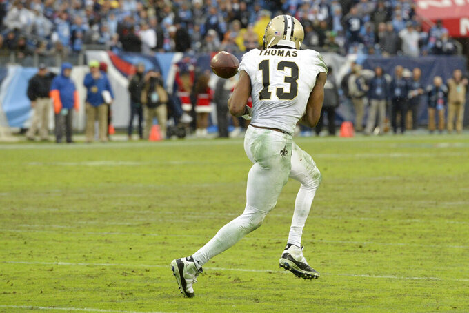 New Orleans Saints wide receiver Michael Thomas (13) makes a reception against the Tennessee Titans in the second half of an NFL football game Sunday, Dec. 22, 2019, in Nashville, Tenn. The catch gave Thomas the single-season pass reception record. (AP Photo/Mark Zaleski)