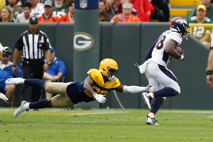 Denver Broncos running back Royce Freeman, right, runs past Green Bay Packers defensive back Darnell Savage during the first half of an NFL football game Sunday, Sept. 22, 2019, in Green Bay, Wis. (AP Photo/Matt Ludtke)