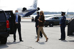 First lady Melania Trump smiles as she arrives at Manchester Regional Airport, Thursday, Sept. 17, 2020, in Manchester, N.H. (AP Photo/Mary Schwalm)