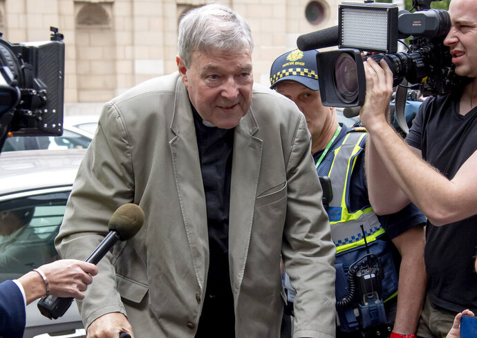 "In this Feb. 26, 2019, photo, Cardinal George Pell leaves the County Court in Melbourne, Australia. Pell's lawyers argued in his appeal that there were more than a dozen ""solid obstacles"" that should have prevented a jury from finding him guilty beyond a reasonable doubt of molesting two choirboys. The appeal court will give their verdict on Aug. 21. (AP Photo/Andy Brownbill)"