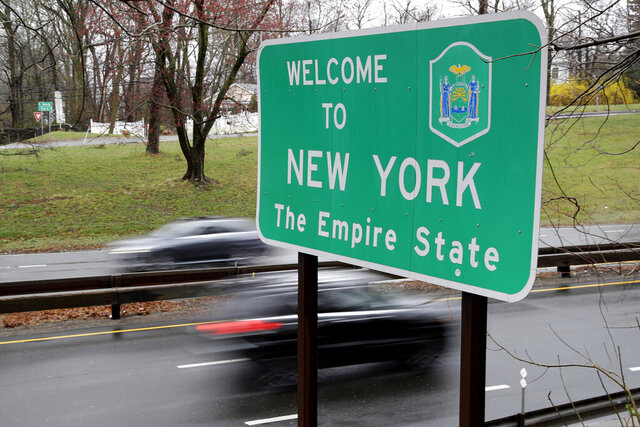 FILE — In this March 29, 2020 file photo, a sign welcomes motorists to New York, on the border with Connecticut, near Rye Brook, N.Y. A federal judge threw out a lawsuit by an Arizona woman who claimed New York's 14-day quarantine requirement for travelers from hotspot coronavirus states infringed on her