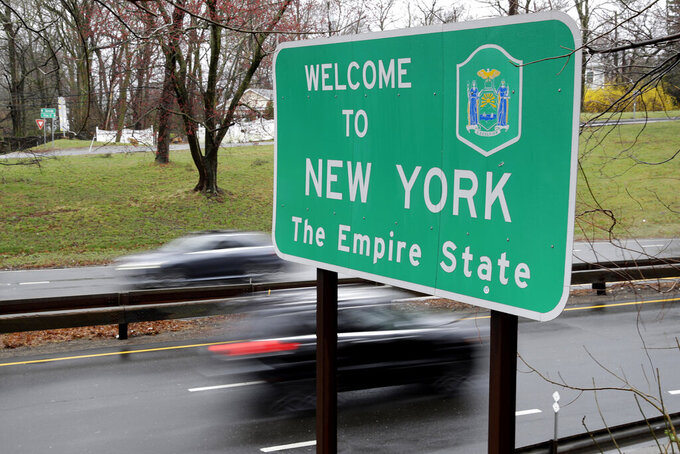 """FILE — In this March 29, 2020 file photo, a sign welcomes motorists to New York, on the border with Connecticut, near Rye Brook, N.Y. A federal judge threw out a lawsuit by an Arizona woman who claimed New York's 14-day quarantine requirement for travelers from hotspot coronavirus states infringed on her """"fundamental right to travel."""" (AP Photo/Seth Wenig, File)"""