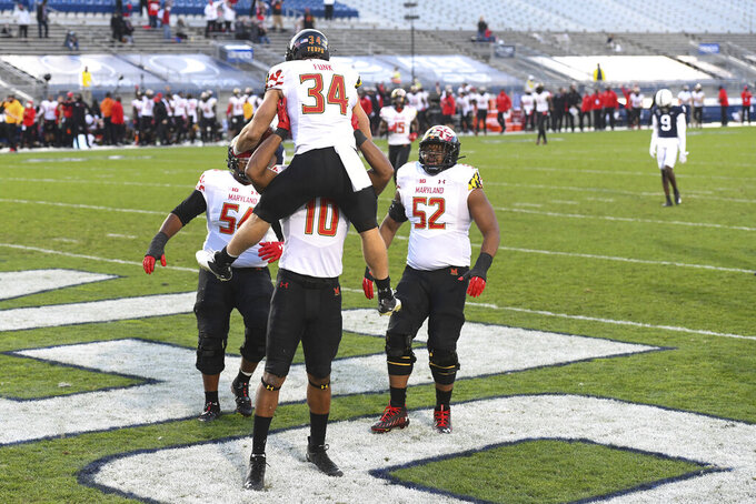 FILE - In this Nov.  7, 2020, file photo, Maryland running back Jake Funk (34) celebrates with teammates after scoring a touchdown run against Penn State during the second quarter of an NCAA college football game in State College, Pa. Maryland, coming off a milestone win over Penn State, faces Indiana on Saturday. (AP Photo/Barry Reeger, File)