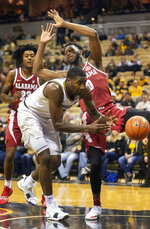 Missouri's Jeremiah Tilmon, foreground, loses the ball out of bounds in front of Alabama's Donta Hall, right, and John Petty, left, during the first half of an NCAA college basketball game, Wednesday, Jan. 16, 2019, in Columbia, Mo. (AP Photo/L.G. Patterson)