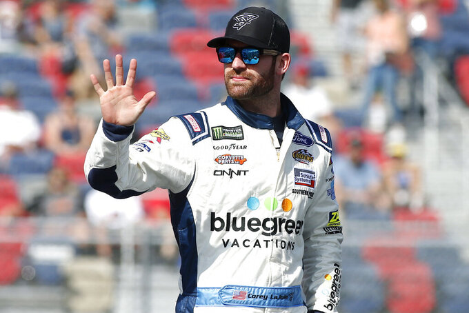 Corey LaJoie waves during driver introductions prior to the NASCAR Cup Series auto race at ISM Raceway, Sunday, Nov. 10, 2019, in Avondale, Ariz. (AP Photo/Ralph Freso)
