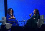 Michelle Obama, left, and Oprah Winfrey speak onstage at