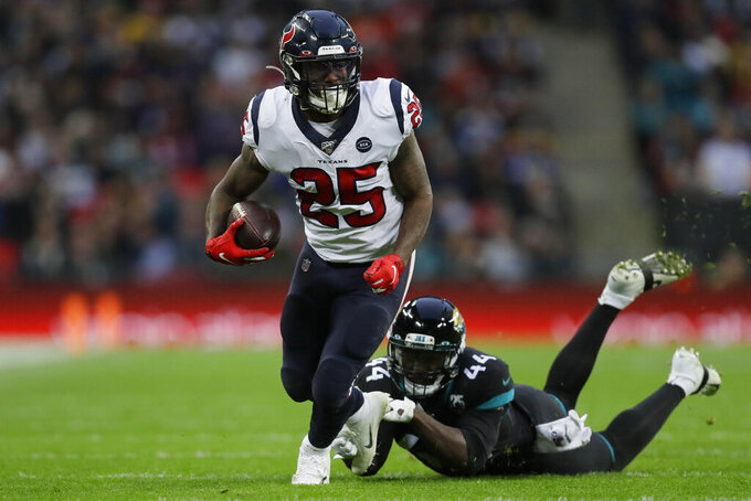 Houston Texans running back Duke Johnson (25) runs against Jacksonville Jaguars middle linebacker Myles Jack (44) during the second half of an NFL football game at Wembley Stadium, Sunday, Nov. 3, 2019, in London. (AP Photo/Kirsty Wigglesworth)