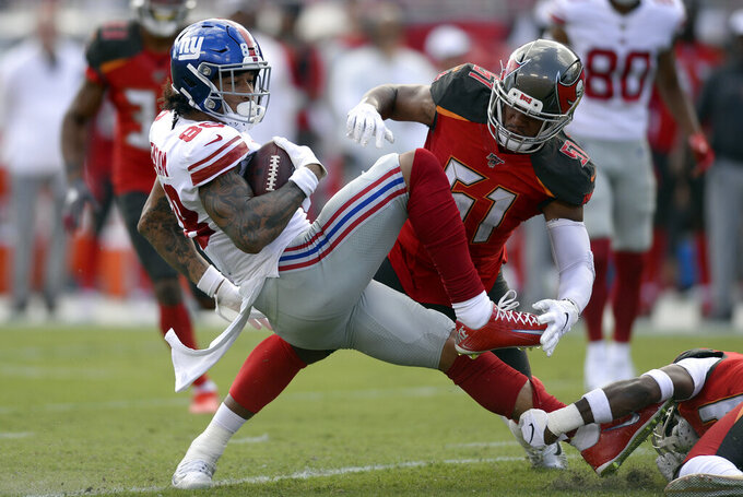 New York Giants tight end Evan Engram (88) gets knocked down by Tampa Bay Buccaneers linebacker Kevin Minter (51) during the first half of an NFL football game Sunday, Sept. 22, 2019, in Tampa, Fla. (AP Photo/Jason Behnken)
