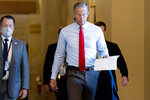 Sen. John Thune, R-S.D., walks out of a meeting in the office of Senate Minority Leader Mitch McConnell of Ky. as a coalition of Democrats and Republicans push the $1 trillion bipartisan infrastructure package closer to passage despite a few holdouts trying to derail one of President Joe Biden's top priorities, at the Capitol in Washington, Monday, Aug. 9, 2021. (AP Photo/Andrew Harnik)